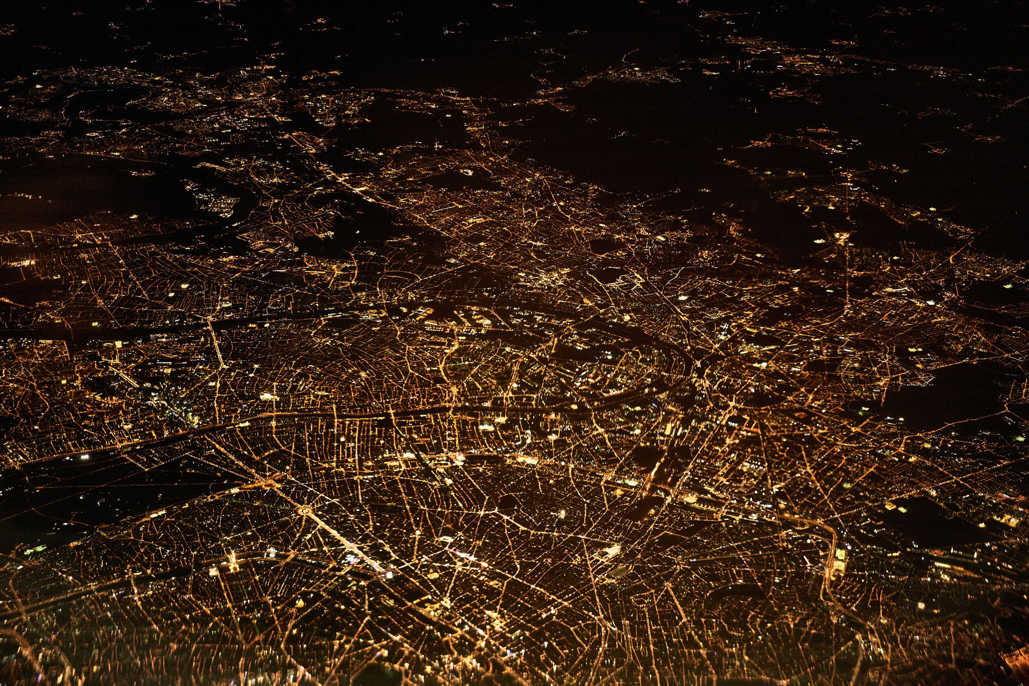 view of connected glowing streets from a high altitude