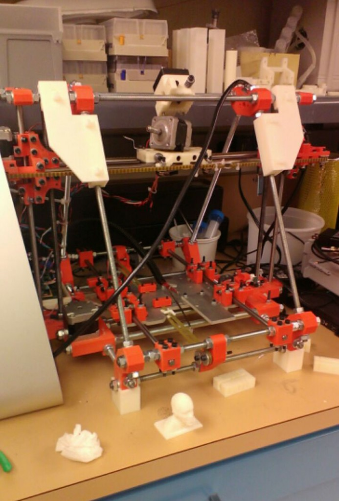 Image of RepRap printer sitting on a countertop.