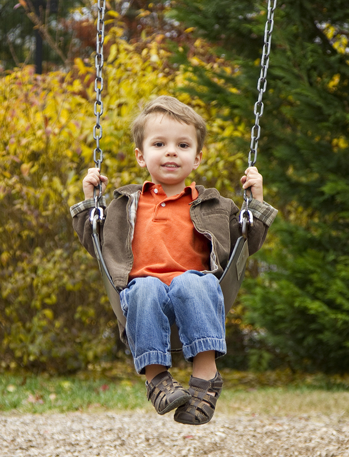 Child sitting on swing