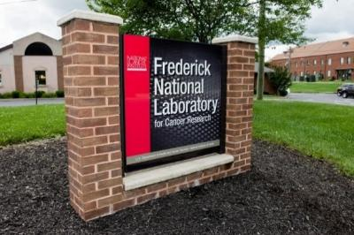 Brick sign outside of building reading, Frederick National Laboratory for Cancer Research